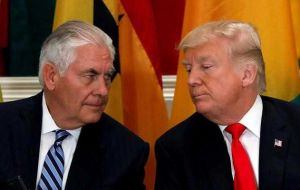 "Trump told reporters he disagreed with Tillerson on some issues and feels he ""will be much happier now."""