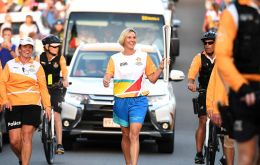 "The Queen's Baton came into the stadium with eight-time Olympic and 15 Commonwealth Games swim medalist ""Madame Butterfly"" Susie O'Neill"