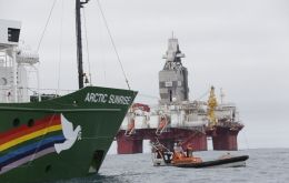 Scientists aboard a Greenpeace ship documented the existence of coral in an area off the northern coast of Brazil and Total's plans to drill for oil should be banned