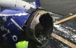 Picture of the exploded engine after the plane landed safely.  (AP)
