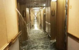 One of the corridors of Deck 9 flooded when the fire suppression system poured gallons of water