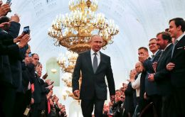 """As head of state, I will do all I can to multiply the strength and prosperity of Russia,"" Putin told a packed room of Russia's political and culture elite"