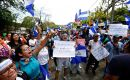 """This is not a forum of dialogue; this is a forum to negotiate your exit,"" one student told Ortega at the start of the event, organized by Roman Catholic bishops."