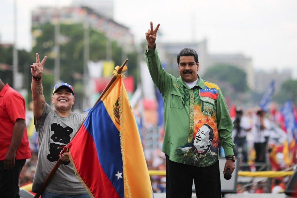 At Maduro's closing campaign in central Caracas Maradona surprised the crowd by dancing a catchy reggaeton song while waving a Venezuelan flag