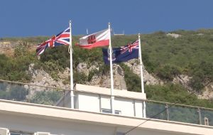The Falklands flag flying next to the Union Jack and Gibraltar's colors