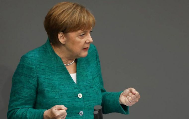 """Europe faces many challenges, but that of migration could become the make-or-break one for EU,"" Merkel said during a passionate address to parliament (Pic Reuters)"