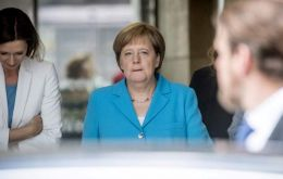 Officials of Merkel's Christian Democrat party broke off their own separate meeting in Berlin about an hour earlier, saying they would resume at 8:30 a.m.