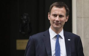 "Jeremy Hunt, who has replaced Mr. Johnson as foreign secretary, said he would be ""four square"" behind her."