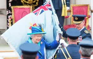 The Queen presented a new Queen's Color to the RAF in the forecourt of Buckingham Palace before moving to the balcony with the royal family
