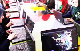 Women learning to code at a technology centre in Herat, western Afghanistan.(PicUNAMA/Fraidoon Poya)