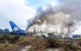 TV images showed the severely damaged body of the plane after it came to rest in scrubland and a column of smoke rose into the sky