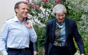 The trip was the prime minister's first domestic appearance since she cut short her summer walking holiday for talks with the French president Emmanuel Macron