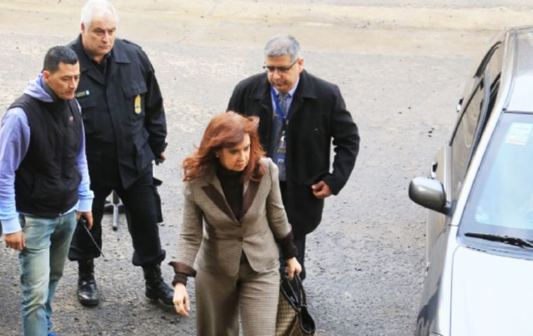 Cristina Fernandez appeared in court and in a written statement said the accusations by Federal Judge Claudio Bonadio are false and politically motivated.