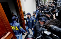 Police officers entered CFK's residence in the exclusive Recoleta neighborhood of Buenos Aires as police vans and fire trucks surrounded the building