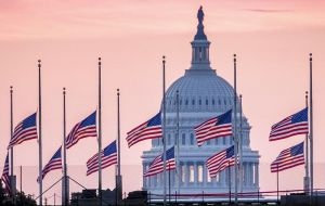 Flags at the US Capitol and other Washington landmarks remained at half-staff earlier on Monday