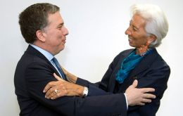 The photo all Argentina was expecting: IMF Managing director Christine Lagarde greets Argentina's Finance minister Nicolas Duvjovne before talks started