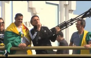 "Bolsonaro, whose trademark pose at rallies is a ""guns up"" gesture, says he would encourage police to kill suspected drug gang members and other armed criminals"
