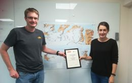 Nathan Fenney and Laura Gerrish with 'Stanfords Award' for the South Georgia and Shackleton Crossing Map.