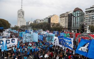 Thousands of public school teachers and university professors marched against Macri's fiscal belt tightening plans in capital Buenos Aires on Thursday