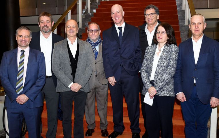 Minister Faurie and ambassador Kent (C) next to other Argentine officials at the San Martin theatre