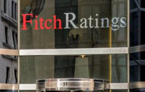 "Fitch envisions ""an acrimonious and disruptive 'no deal' Brexit"" which will impact the UK's economy negatively."