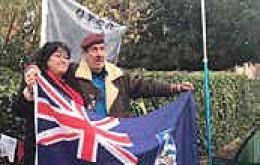 MLA Roberts stands with Gus Hale next to his tent in<br /> Shropshire