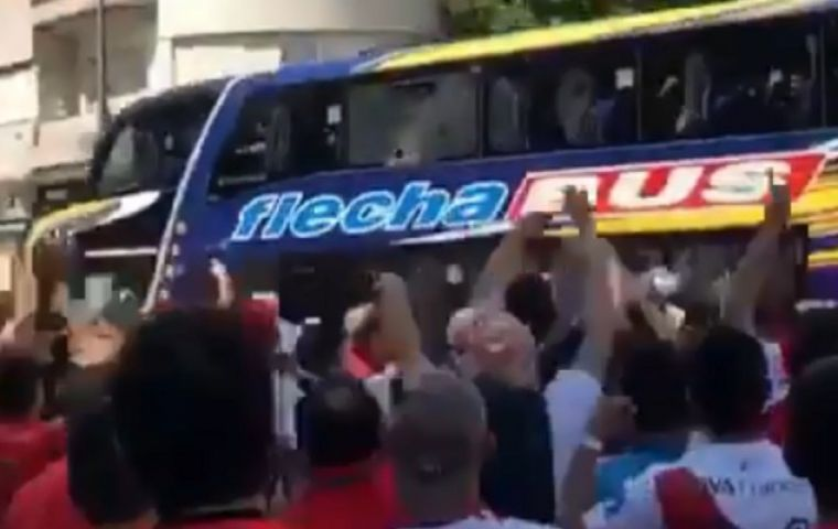 The Boca bus under attack by hooligans
