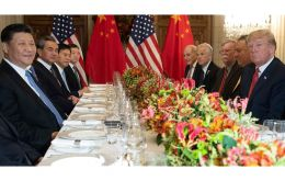 Xi Jinping and Donald Trump sit beside fellow members of the Chinese and U.S. delegations at Saturday night's working dinner in Buenos Aires.