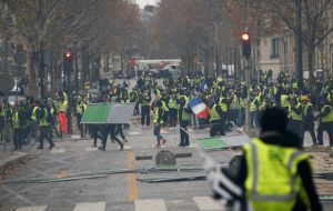 Protesters wearing their signature fluorescent yellow vests kept blocking several fuel depots. In Marseille, students clashed with police outside a high school