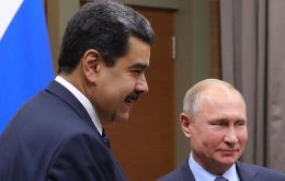 Putin helps Maduro in return for what?