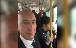 """What a storm. Returning soaking wet in the bus"" twitted ambassador Kent, while sharing pics of him at the bus stop and in the crowded bus.(Pic Twitter)"