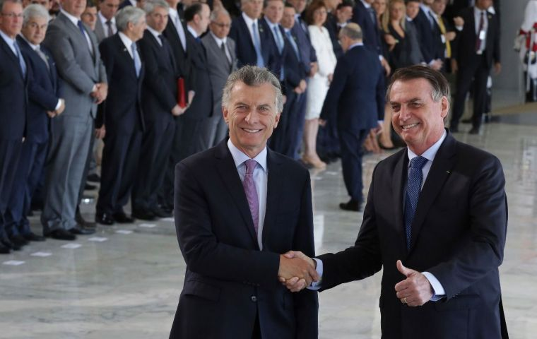 "The two leaders meeting for the first time underlined their opposition to Venezuela's authoritarian regime, and Macri called Nicolas Maduro a ""dictator"""