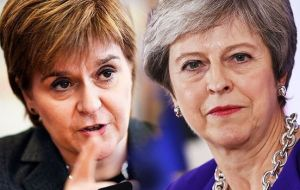 The row mirrors the divide between the two leaders over Brexit, with Ms Sturgeon urging Mrs. May to consider a fresh referendum on EU membership