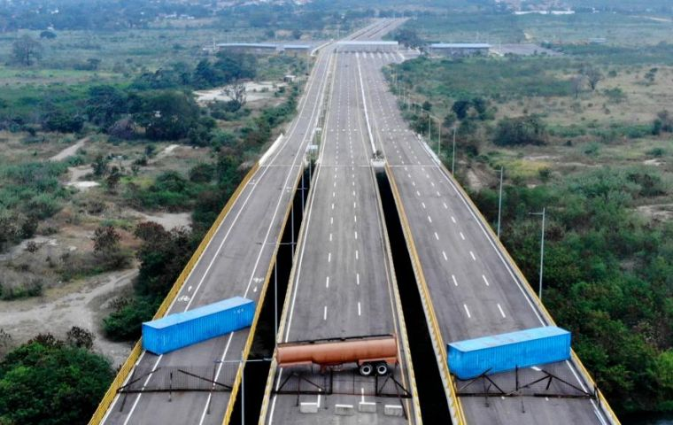 Late Tuesday, the army blocked a road on the Colombian border. Troops used a tanker truck and shipping containers to impede access to the Tienditas bridge