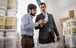 Guaido tweeted a photo of himself surrounded by stacks of white pots of vitamin and nutritional supplements. He did not say from where or whom they came.