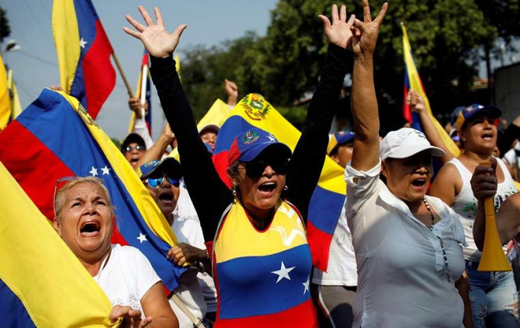 Tens of thousands of protesters had taken to the streets to demand that Maduro allow aid into Venezuela, where food and medicine shortages are rife.