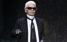 Lagerfeld signature ponytail and dark glasses made him an instantly recognizable figure around the world