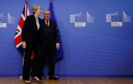 Looking tense, Mrs May met the head of the European Union's executive arm, Mr Jean-Claude Juncker, on Wednesday evening