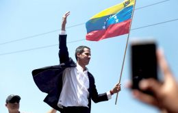 """We know the risks we face, that have never stopped us. The regime, the dictatorship must understand,"" a defiant Guaido told a delirious crowd"