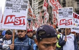 "Thousands of protesters marched along roads near the city centre carrying colorful banners with slogans asking for ""decent work"" and ""better salaries""."
