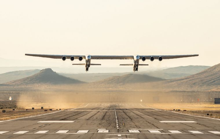 With a dual fuselage design and wingspan greater than the length of an American football field, the Stratolaunch aircraft took flight from the Mojave Air Base