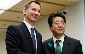 On the first day of his trip to Japan, Mr Hunt met the country's prime minister Shinzo Abe and other political leaders (Pic AFP)