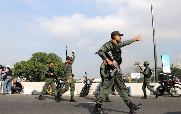 A small number of military personnel joined opposition leader Guaido outside an air base in Caracas on April 30, calling on those inside to join the rebellion.