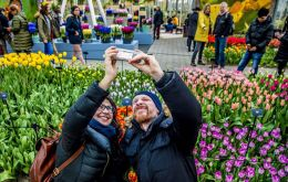 Dutch Tourism will stop promoting Netherlands as a holiday destination because its main attractions, canals, tulips, and windmills, are becoming overcrowded  (Robin Utrecht/AFP/Getty Images)