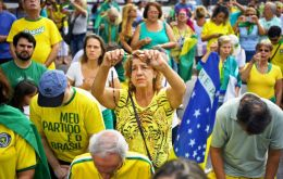 "Waving flags and chanting Bolsonaro's nickname ""Mito"", protesters with T-shirts emblazoned with ""My party is Brazil"" demanded lawmakers speed up reforms"