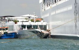 Tourists on the harbor could be seen running away as the 13-deck MSC Opera scraped along the dockside, its engine blaring, before knocking into a tourist boat