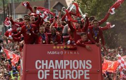 Supporters turned Liverpool into a sea of red as the open-top bus carrying coach Jurgen Klopp and his victorious players edged through the city