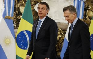 "Argentina and Brazil ""will do everything possible to restore democracy in Venezuela,"" president Mauricio Macri said while standing next to Bolsonaro"