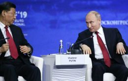 "Denouncing the ""rhetoric of trade wars and sanctions"", Putin called for rethinking the role of the US dollar and slammed US pressure on both countries."