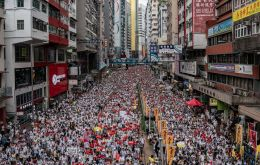 What began as a largely peaceful rally outside the Legislative Council turned chaotic as tens of thousands of protesters charged at the police